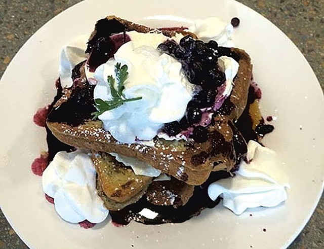 Carriage House Café & Grill's blueberry-stuffed waffles - COURTESY OF CARRIAGE HOUSE CAFÉ & GRILL