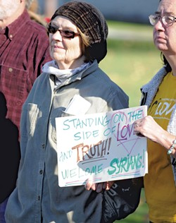 Judy Copa listening to speakers in support of Syrian refugees - JEB WALLACE-BRODEUR