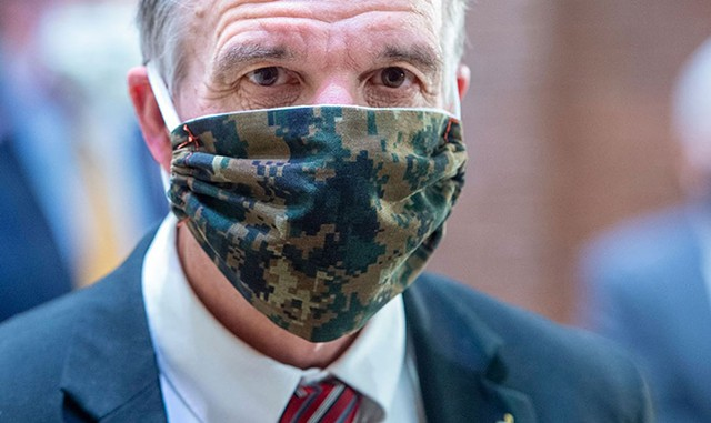 Gov. Phil Scott wearing a face mask at an April press conference in Montpelier - FILE: JEB WALLACE-BRODEUR