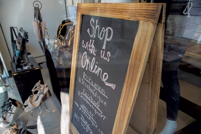 Sign in front of Jess Boutique - JAMES BUCK