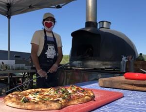 Tucker Levy manning the NOFA-VT pizza oven - JORDAN BARRY