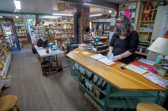 Comanager Regina Thompson checking orders at the Adamant Co-op - JEB WALLACE-BRODEUR