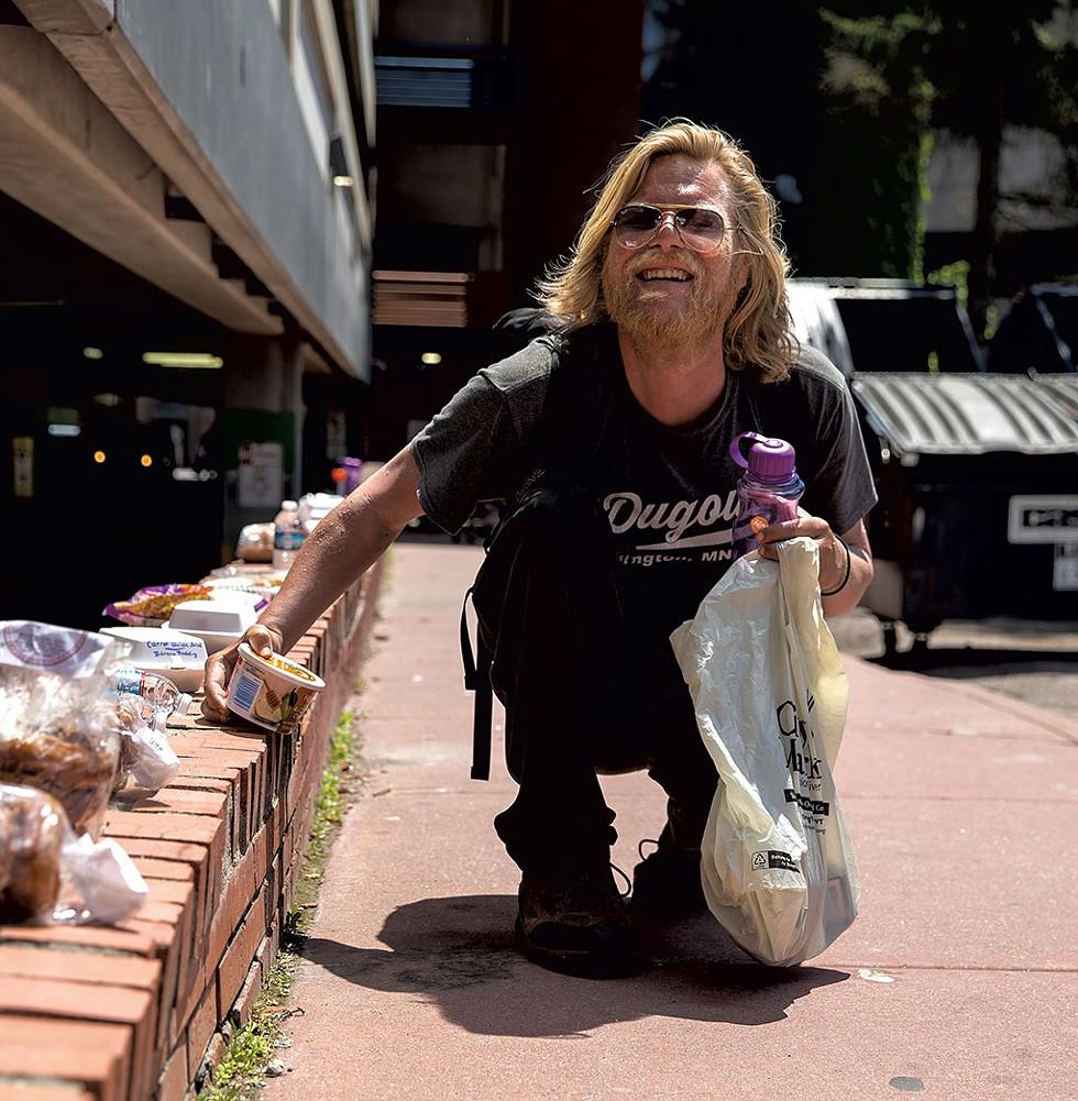 Alex Olsen picking up food and supplies - JAMES BUCK