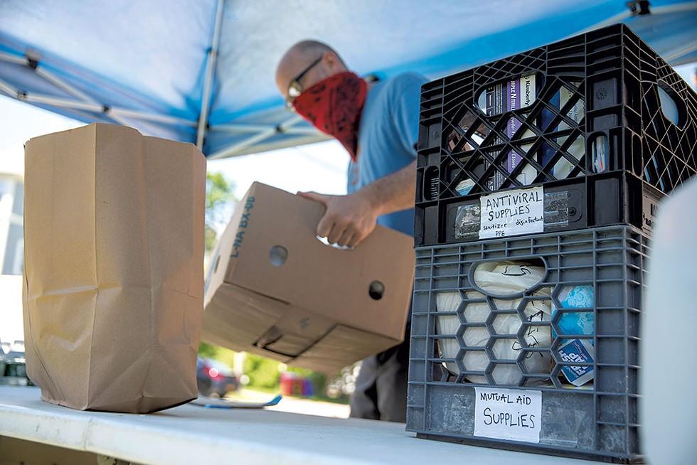 Food Not Bombs receiving donations in Burlington - JAMES BUCK