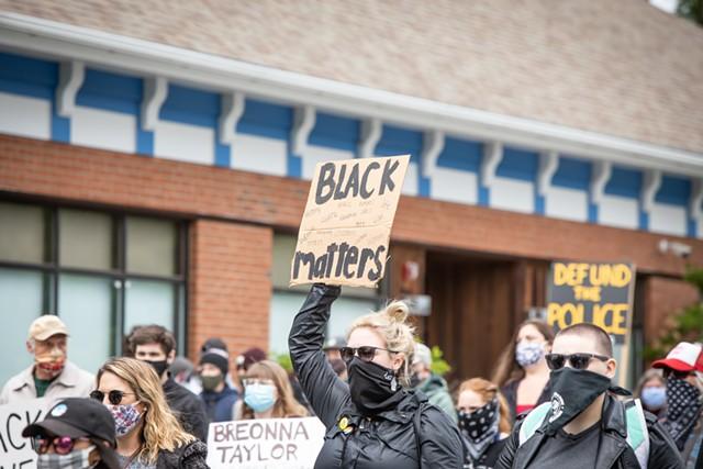 Demonstrators marching in Colchester - LUKE AWTRY