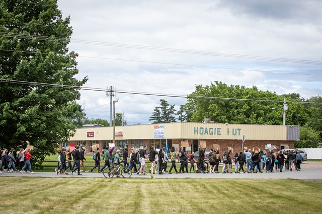 Marching past the Hoagie Hut - LUKE AWTRY