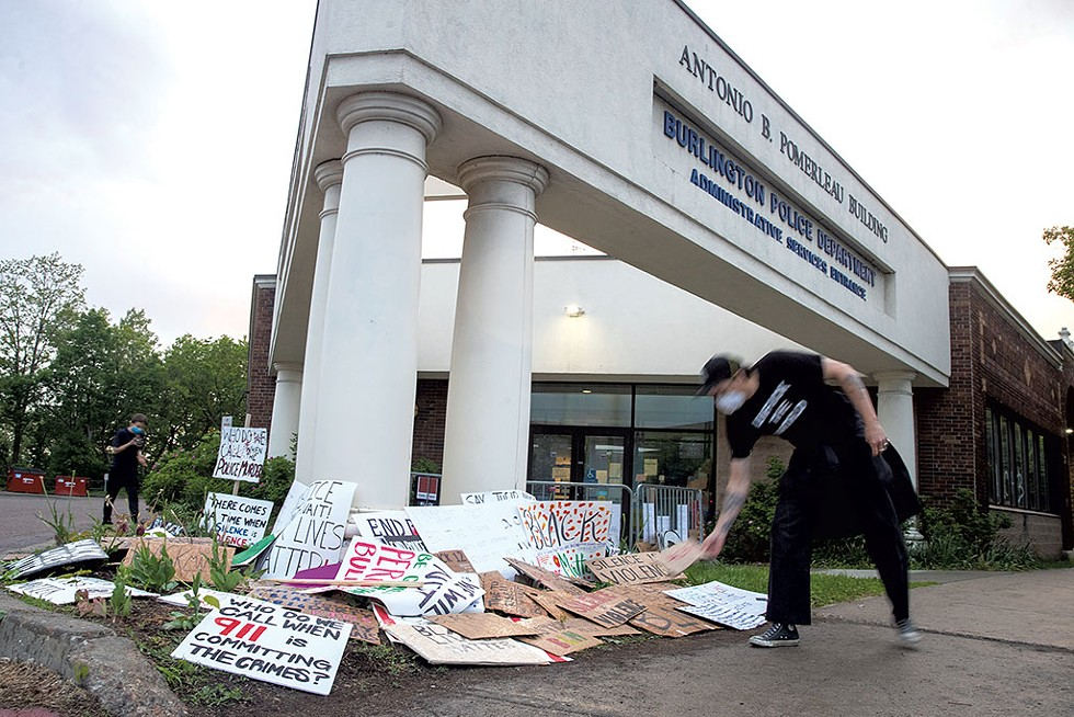 Protesters leaving signs outside the Burlington Police Department after a May 30 rally - JAMES BUCK