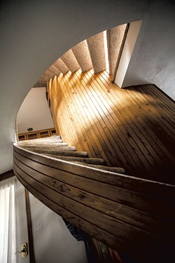 A circular staircase wraps around the central core. - TOM MCNEILL
