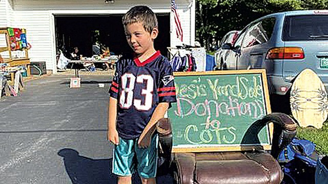 Desi Hong at his yard sale - COURTESY OF CHARLIE WHITNEY