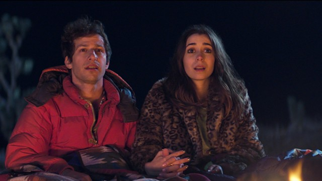Andy Samberg and Cristin Milioti relax into the time-loop lifestyle in Palm Springs. - HULU