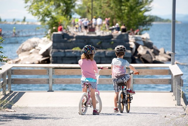 Children wait on the ferry dock - COURTESY OF LOCAL MOTION
