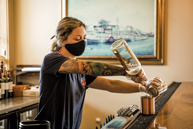 Bartender Morgan McAvoy mixing drinks at Burlington's Shanty on the Shore in June - LUKE AWTRY