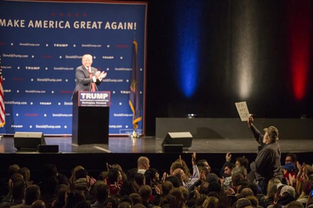 Donald Trump applauds a supporter Thursday night at the Flynn - JAMES BUCK