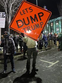 Protesters outside Trump's rally in Burlington Thursday - MATTHEW THORSEN