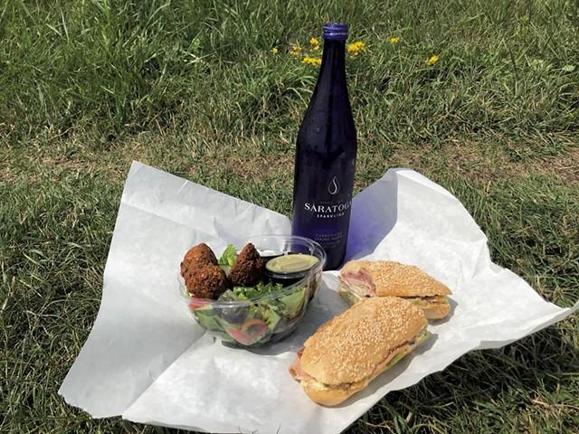 A Beach hoagie and a falafel salad from Haymaker Bun - SALLY POLLAK ©️ SEVEN DAYS