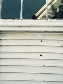 Bullet exit holes - MARK DAVIS