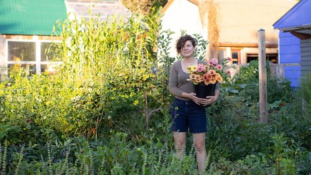 Kelsey Adams, owner of West Lane, in her Winooski backyard - LUKE AWTRY