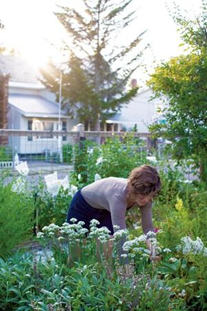 Kelsey Adams in her Winooski backyard - LUKE AWTRY