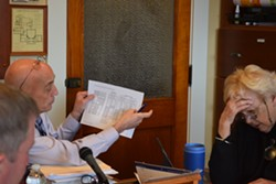Mark Perrault, analyst with the legislature's Joint Fiscal Office, explains issues with a spending cap to the House Education Committee on Tuesday. - TERRI HALLENBECK