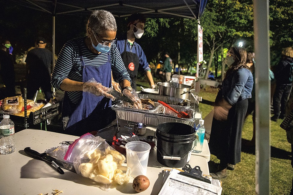 People's Kitchen serving dinner at the encampment - JAMES BUCK