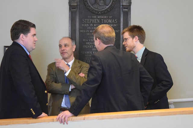 House Speaker Shap Smith (D-Morristown), back to camera, confers Friday afternoon with Reps. Oliver Olsen (I-Londonderry), left, and Adam Greshin (I-Warren) and Smith's aide, Dylan Giambatista. - TERRI HALLENBECK