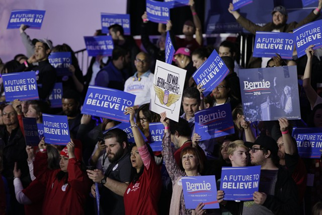 Supporters cheer Sen. Bernie Sanders Monday night in Des Moines. - KRISTIAN DAY