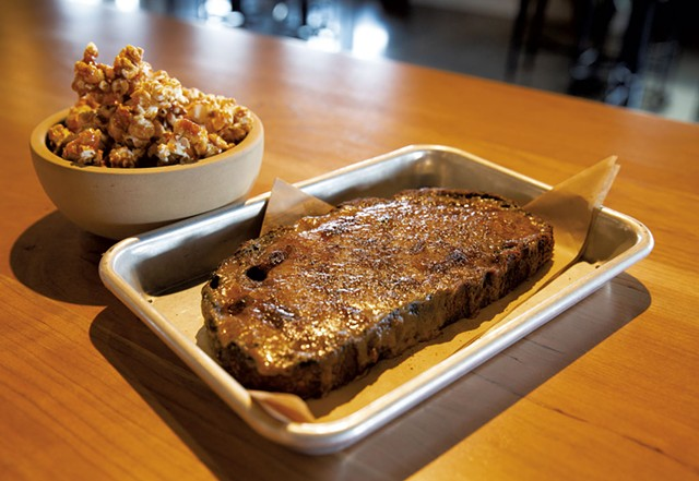Bourbon caramel popcorn (left) and Welsh rarebit - JAMES BUCK