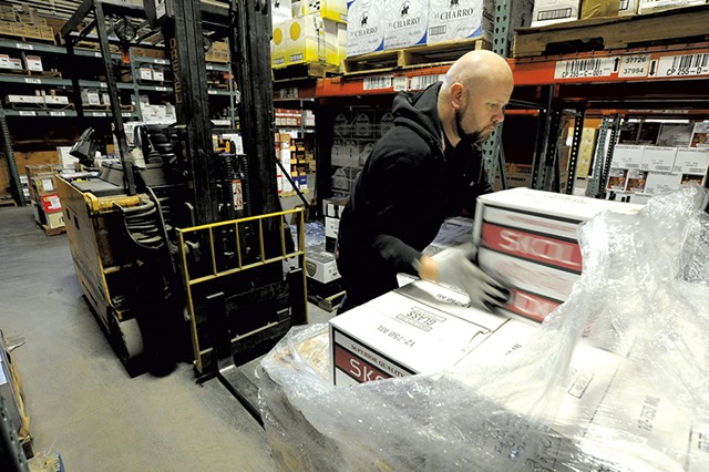 Matt Aubut unloading a pallet of vodka at the Department of Liquor Control warehouse - JEB WALLACE-BRODEUR