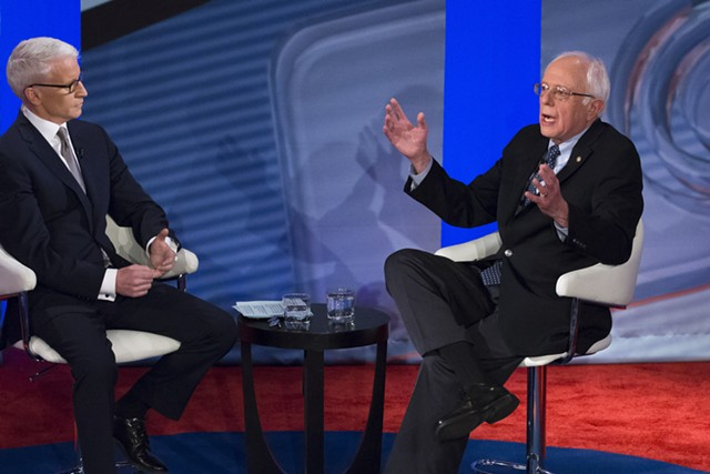 Democratic presidential candidate Sen. Bernie Sanders (I-Vt.), right, speaks with host Anderson Cooper during a town hall in Derry, N.H. - AP PHOTO/JOHN MINCHILLO