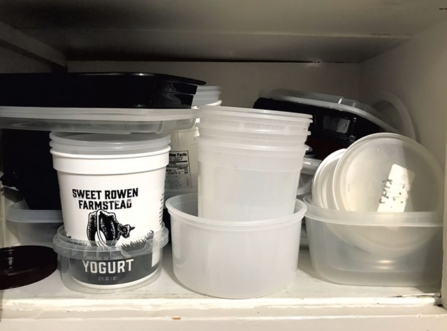 Takeout containers in author's cupboard - SALLY POLLAK ©️ SEVEN DAYS