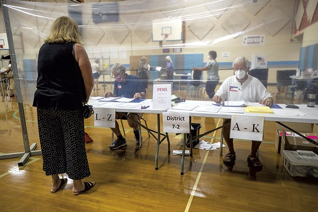 Voting in-person in South Burlington last summer - FILE: JAMES BUCK