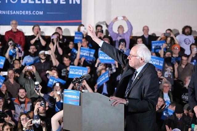 Sen. Bernie Sanders speaking to supporters - PAUL HEINTZ