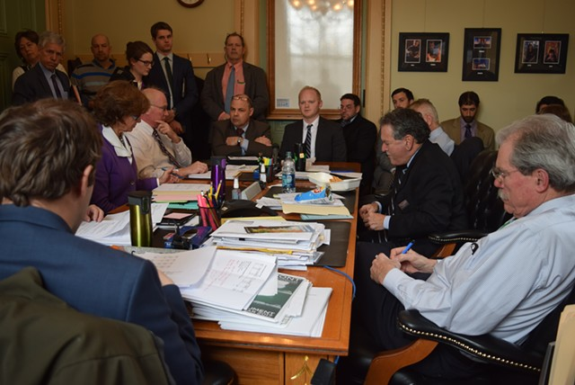 Finance Commissioner Andy Pallito (left, end of table) and James Pepper, the Shumlin administration's director of intergovernmental affairs and policy adviser, address the Senate Finance Committee. - TERRI HALLENBECK