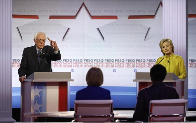 Sen. Bernie Sanders and former secretary of state Hillary Clinton debate Thursday night in Milwaukee, Wisconsin. - AP PHOTO/MORRY GASH