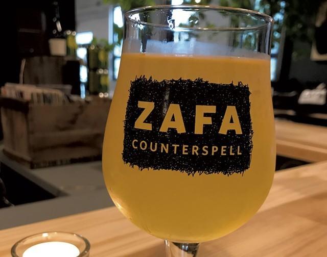 A glass of natural ZAFA wine - SALLY POLLAK/FILE ©️ SEVEN DAYS