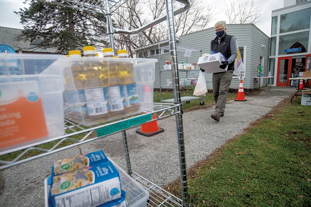 John Tuthill bringing a box of perishables to a customer's car at the Hardwick Area Food Pantry - JEB WALLACE-BRODEUR