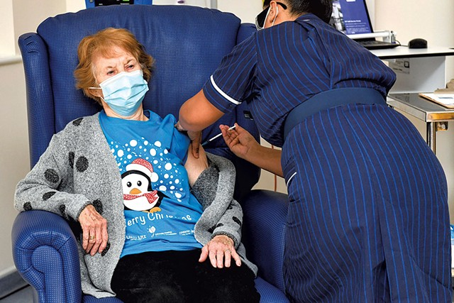 Margaret Keenan, 90, on Tuesday became the first patient in the United Kingdom to receive the Pfizer-BioNTech COVID-19 vaccine - JACOB KING/POOL VIA AP
