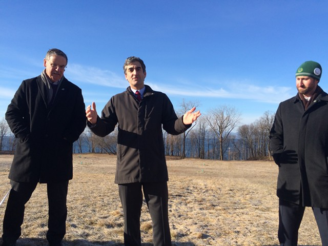 From left, Vermont Land Trust president Gil Livingston, Mayor Miro Weinberger and Parks, Recreation & Waterfront Director Jesse Bridges stand in front of the future parkland. - ALICIA FREESE