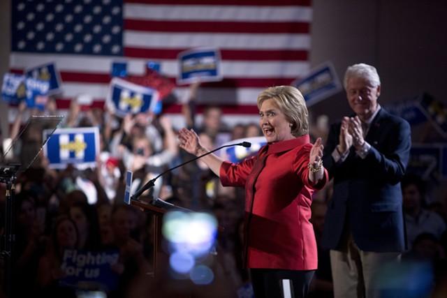 Hillary Clinton and Bill Clinton celebrate Saturday at Caesars Palace in Las Vegas. - LAS VEGAS SUN/STEVE MARCUS VIA AP