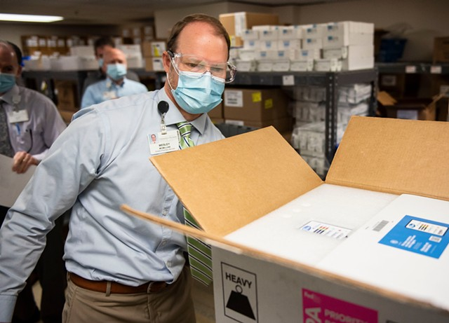 Wesley McMillian, director of pharmacy at UVM Medical Center, with a shipment of vaccine - COURTESY OF THE UNIVERSITY OF VERMONT MEDICAL CENTER
