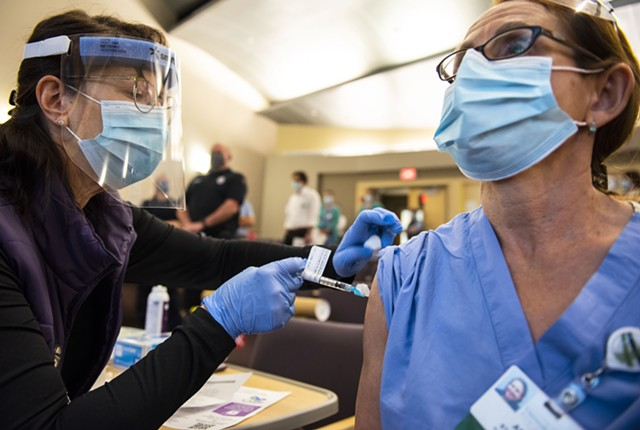 Health care workers receive the COVID-19 vaccine on Tuesday afternoon - COURTESY OF RYAN MERCER/UVM HEALTH NETWORK