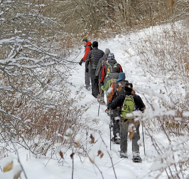 Guests on a snowshoe and tubing tour - COURTESY OF UMIAK OUTDOOR OUTFITTERS