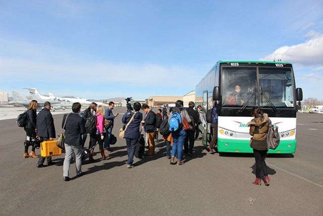 Sen. Sanders' traveling press corps board a bus at Reno-Tahoe International Airport - PAUL HEINTZ