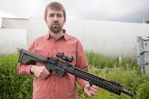 Heintz with the AR-15 he bought in a parking lot - FILE: JAMES BUCK