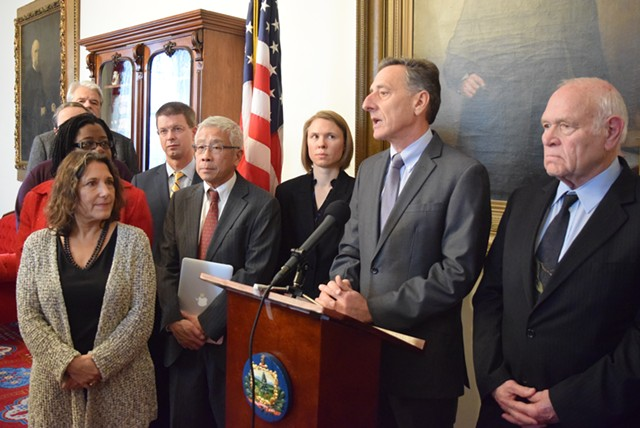 Gov. Peter Shumlin, with his health and environmental managers and lawmakers, outlines the water contamination problem in North Bennington. - TERRI HALLENBECK