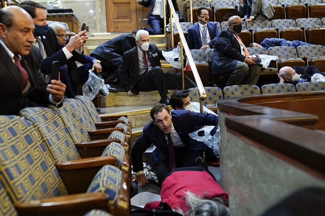 U.S. Rep. Peter Welch (D-Vt.) and others ducking for cover as rioters swarmed the U.S. Capitol - ASSOCIATED PRESS