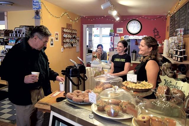 Sarah Copeland Hanzas, right, talks with Bruce Murray at the Local Buzz, her Bradford café - TERRI HALLENBECK