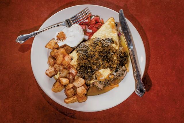 Pork carnitas omelette at Firebird Café - FILE: GLENN RUSSELL