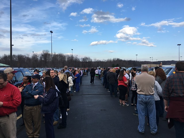 Trump fans wait in line Monday for a rally in Vienna, Ohio. - PAUL HEINTZ