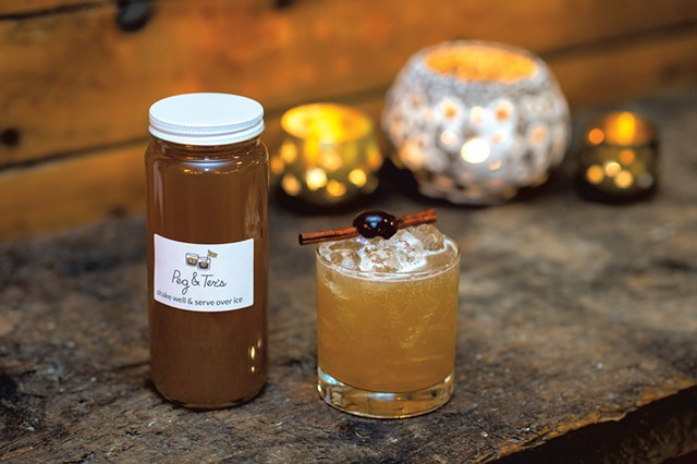 Apple brandy sour to-go (left) and in a glass - DARIA BISHOP